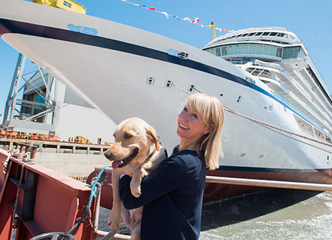 Viking Sea's godmother, Karine Hagen, and her traveling yellow Labrador, Finse, during the ship's float out ceremony on June 25
