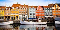 Boats and rowhouses in Nyhavn Harbor in Copenhagen, Denmark