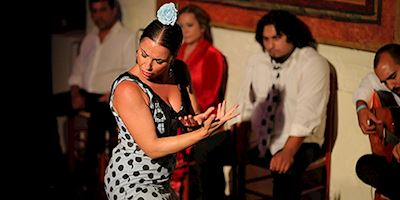 Flamenco dancer performing with musicians