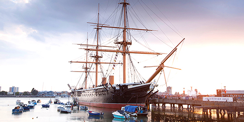HMS Warrior Ship with large masts in Portsmouth, England.