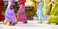 Women walking in front of Shwedagon Pagoda
