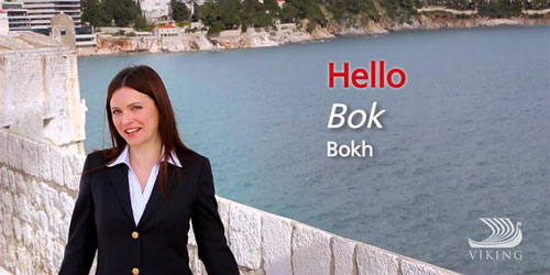 "A woman dressed in a blazer standing over water, with the words ""Hello"" ""Bok"" ""Bokh"" in text."